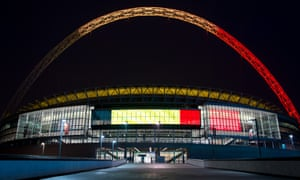 The arches of Wembley Stadium are illuminated with the colours of the flag of Belgium on March 23.