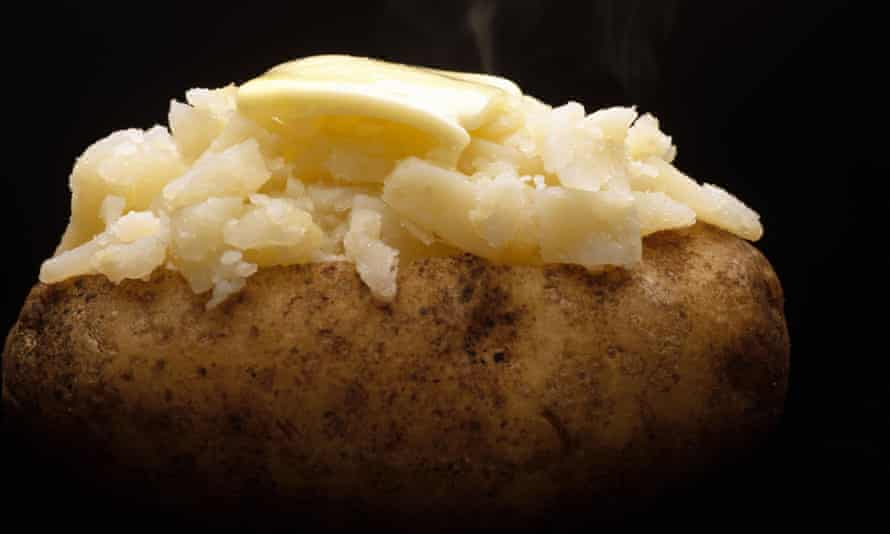A baked potato with butter