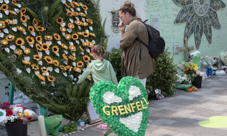 Mourners at the Grenfell memorial display last month in London.