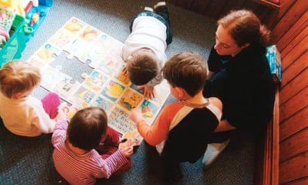 Trainee nursery worker with small children