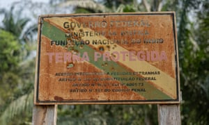 A bullet-riddled sign warning outsiders off the Uru-Eu-Wau-Wau reserve