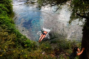 Delvine, Albania: A man jumps to cool off in the Blue Eye river