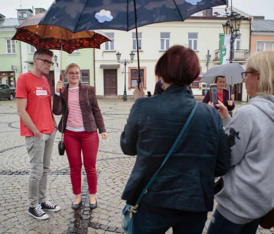 Tuleya poses for a photo with a supporter in Chełm.