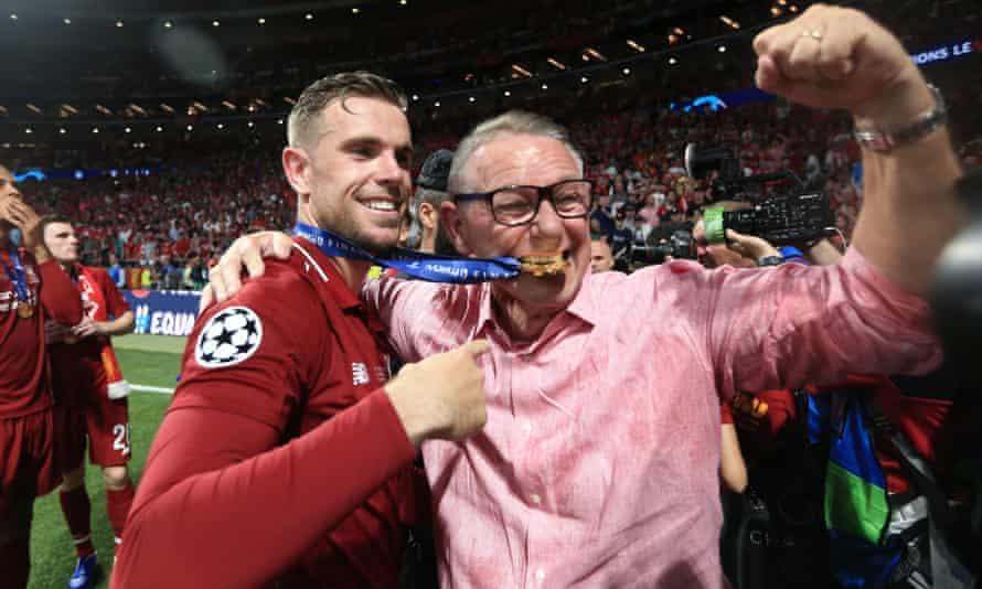 Jordan Henderson hugs his father Brian after Liverpool's Champions League triumph.
