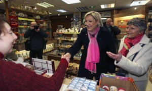 Marine Le Pen talks to shopkeepers during a visit in Le Mont Saint-Michel.