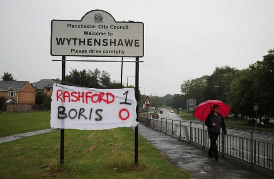 A banner in Wythenshawe after Boris Johnson agreed to extend free school meals during the summer holidays in England.