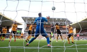 Aymeric Laporte heads the equaliser past Wolves goalkeeper Rui Patrício.