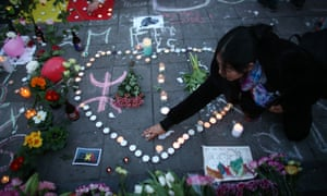 People gather to leave tributes at the Place de la Bourse following attacks in Brussels, Belgium on March 22, 2016.