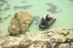 Officers patrol in a rubber dinghy near Carbis Bay