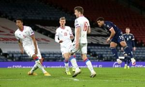 Scotland's Che Adams thumps home his first international goal.