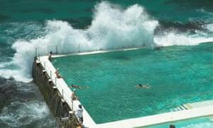 A wave breaks over the Bondi Icebergs pool in Sydney