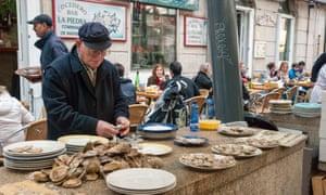 Man opening oysters on street, Vigo