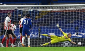 Sheffield United goalkeeper Aaron Ramsdale makes a save from Chelsea's Ben Chilwell.