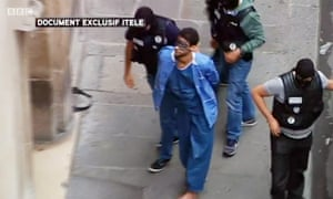 Ayoub el-Khazzani is escorted to a court hearing in Paris by security personnel, as seen in BBC footage.