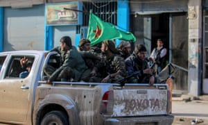 Kurdish fighters in Syrian city of Qamishli in February