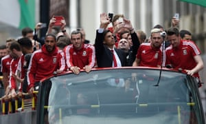 Chris Coleman, centre, and his Wales players during a homecoming celebration in Cardiff following their run to the semi-finals of Euro 2016.
