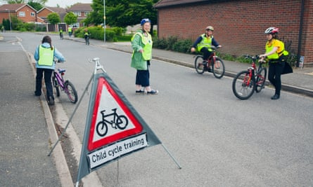 England, Lincolnshire, School children being taught cycle safety lessons on public roads.