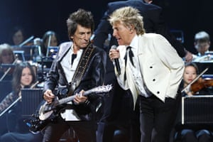 Ronnie Wood and Rod Stewart performing at Brit awards show. They were joined by Kenney Jones in a reunion of the Faces.
