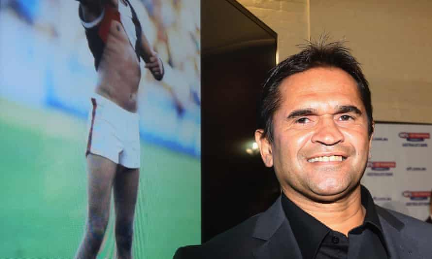 Nicky Winmar with the photograph of him lifting his shirt after receiving racist abuse. A statue of the moment will be unveiled in Perth next month