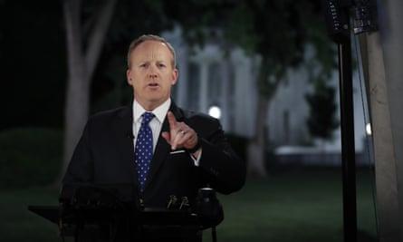 White House press secretary Sean Spicer talks to media following Donald Trump's abrupt dismissal of FBI director James Comey.