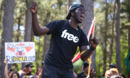 """An activist chants in protest of the """"pro-white"""" rally at Stone Mountain Park"""