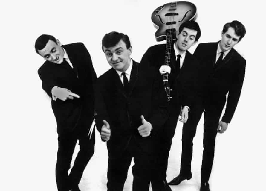 Gerry Marsden, second from left, with Gerry and the Pacemakers, from left, Freddie Marsden, Les Chadwick and Les Maguire. The band reached No 1 with their first three singles.