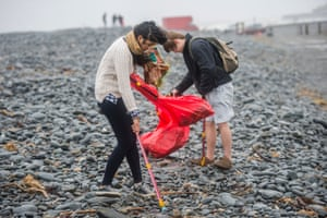 'Tut-tutting achieves nothing' … volunteers clean litter off the beach at Aberystwyth.