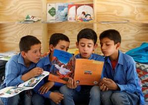 Boys reading a book