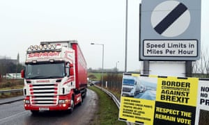 A lorry passes an anti-Brexit placard at the Ireland-Northern Ireland border crossing in Killeen