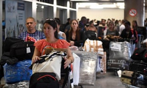 A group of Cuban doctors head for the check-in at Brasilia's airport, Brazil, to fly back to Cuba in November.