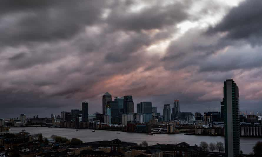 Skyline of London and the Thames, with dramatic clouds of Storm Barney and its 40mph winds