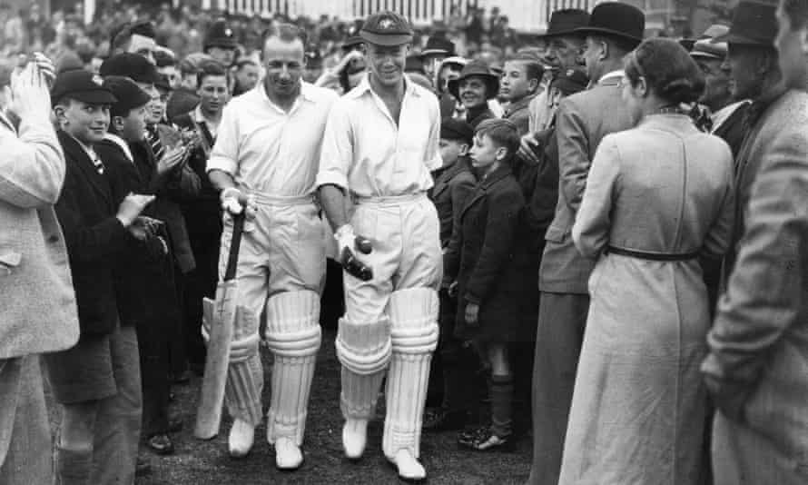 Don Bradman, left, and Bill Brown walk out to bat.