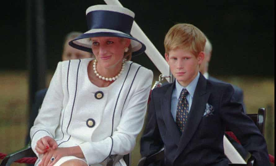 Princess Diana, looking relaxed and glamorous, and a young Prince Harry, in a suit looking nervous, sitting side by side, in 1995