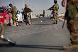 Afghan army soldiers manning a checkpoint on the outskirts of Kandahar
