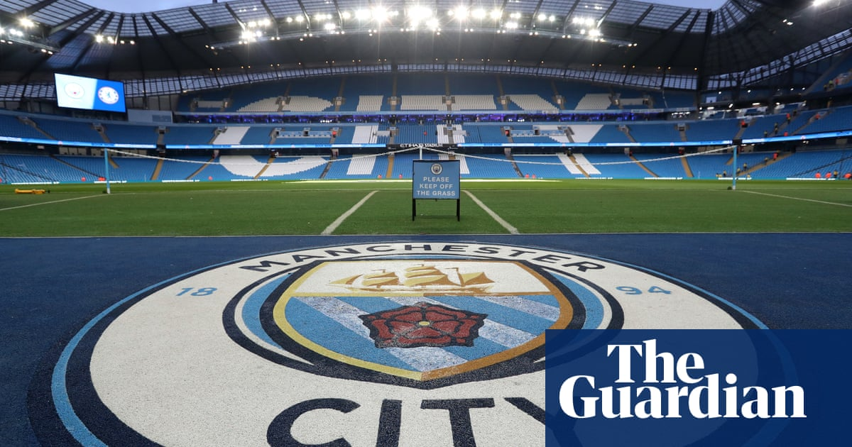 Manchester City fan remains in coma as five men appear before judge