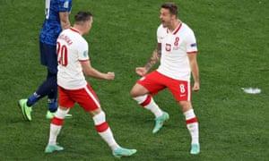 Karol Linetty (R) of Poland celebrates scoring.