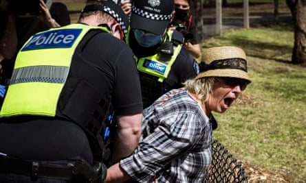A woman is detained by Victoria police at Elsternwick Park in Melbourne, Australia