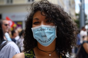 """Marseille, France A healthcare worker wearing a mask reading """"Masked but not muzzled"""" takes part in a demonstration as part of a nationwide day of protests to demand better working conditions"""