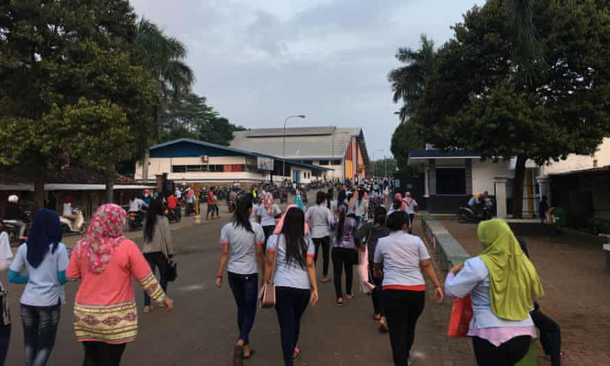 Staff arrive for worth at the PT Buma factory in Subang, Indonesia, which makes Ivanka Trump branded clothing.