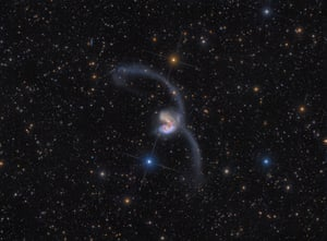 Two galaxies collide in space.