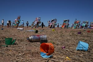 Amarillo, USEmpty paint canisters are seen at Cadillac Ranch, a public art installation and sculpture in Texas. It was created in 1974 by Chip Lord, Hudson Marquez and Doug Michels, who were a part of the art group Ant Farm. The installation consists of ten Cadillacs buried nose-first in the ground