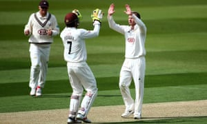 Gareth Batty of Surrey, right, celebrates with Ben Foakes after getting the wicket of Lancashire's Jordan Clark.