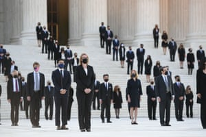 People wait for Ginsburg's casket to arrive at the supreme court on Wednesday.