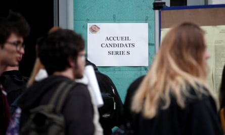 Students at a lycée in Versailles arrive for a philosophy exam