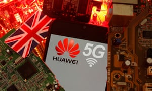 The British flag and a smartphone with a Huawei and 5G network logo are seen on a PC motherboard.