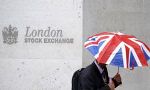 A worker outside the London Stock Exchange