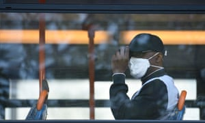 A man wearing a protective face mask on a bus in central Manchester.