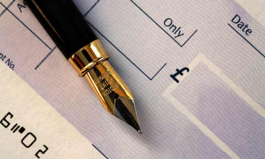 Fountain pen on a chequebook