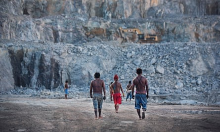 Indigenous men survey the quarry site for the Belo Monte dam, Brazil's largest engineering project.
