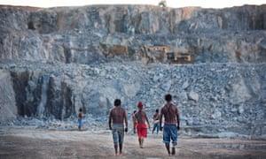 Indigenous Munduruku men survey the quarry site for the Belo Monte dam.